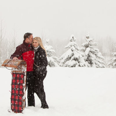 Snowy Sun Valley Engagement Session With Toboggan