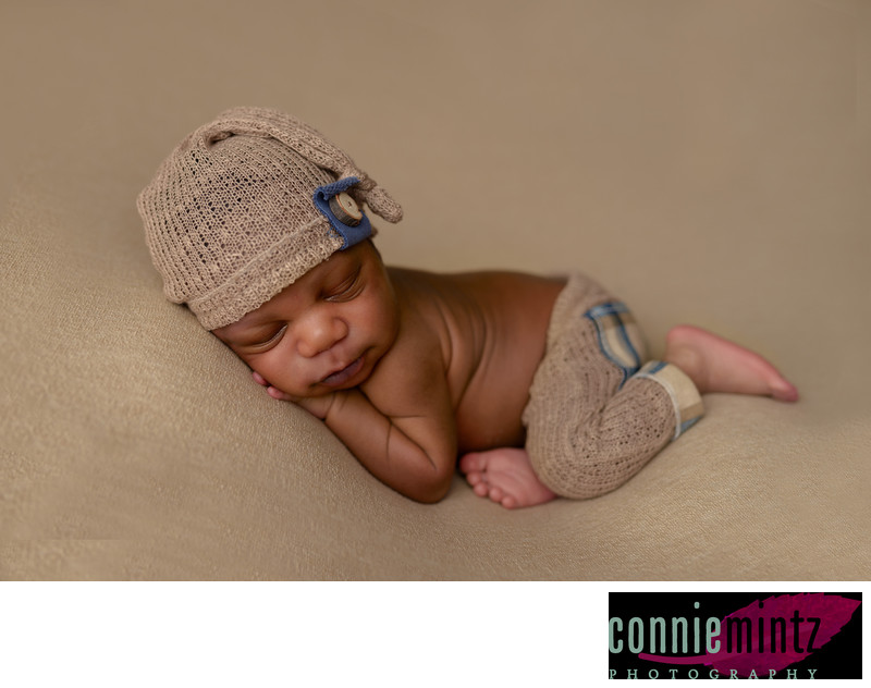 Newborn in Brown hat and pants