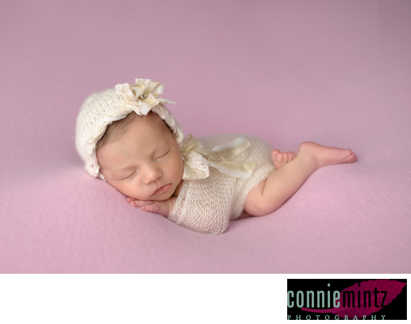 Newborn photography mold them into curl squishy poses.