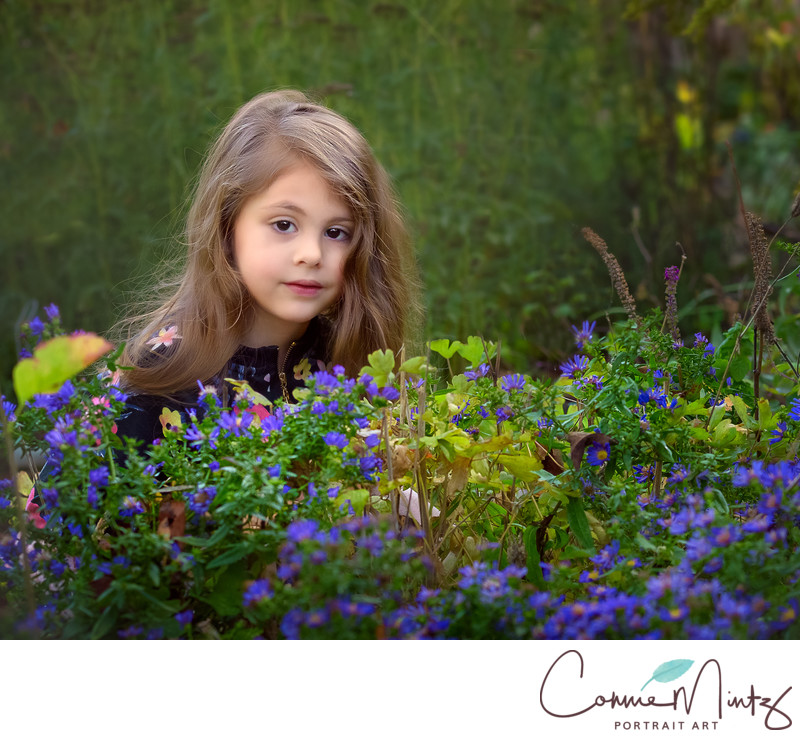 Young girl in purple flowers