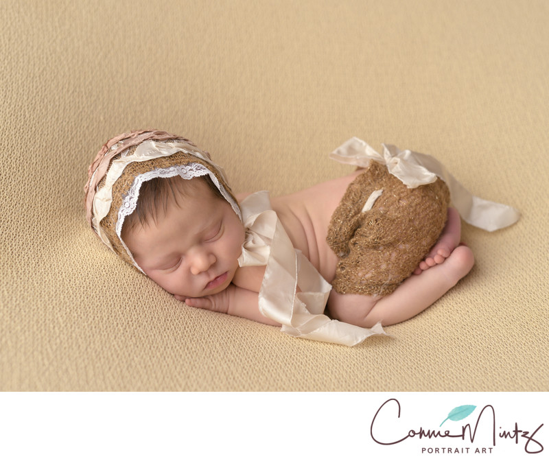 Newborn in gold bonnet