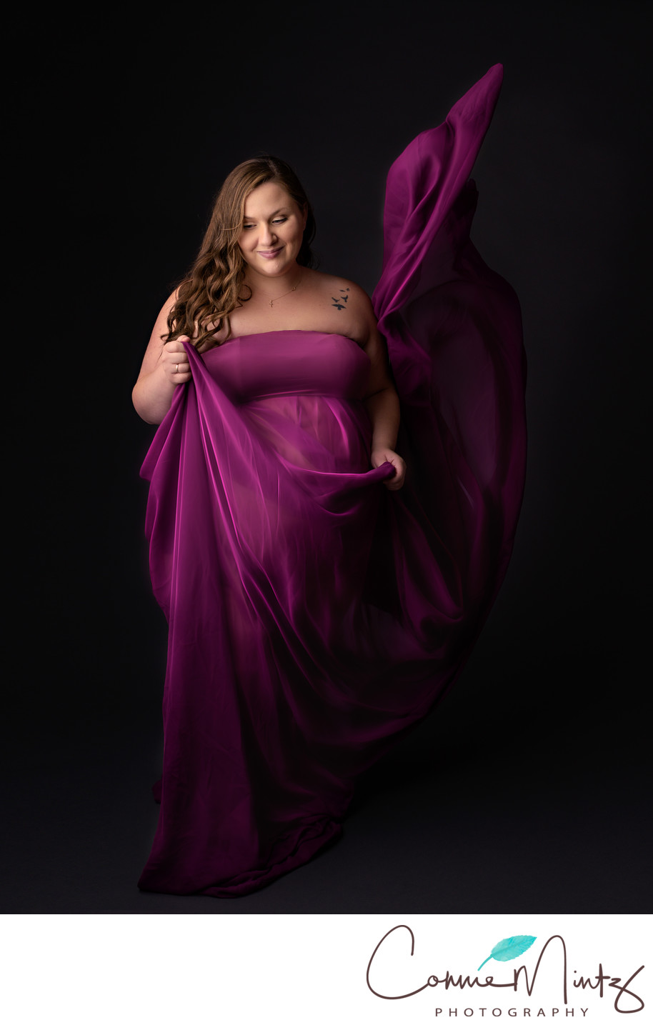 Maternity in magenta gown