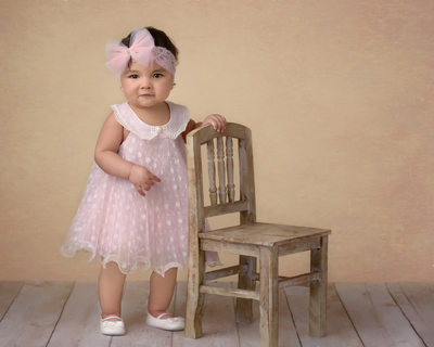 One year old studio portrait in pink