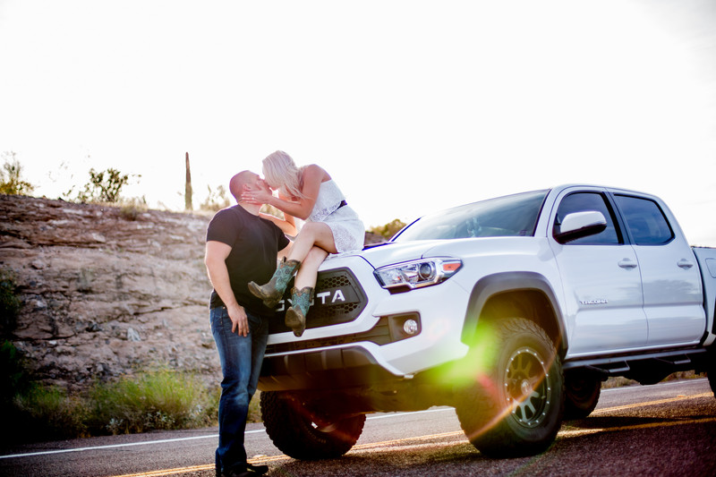 Kissing on a truck Engagement Session Lake Pleasant