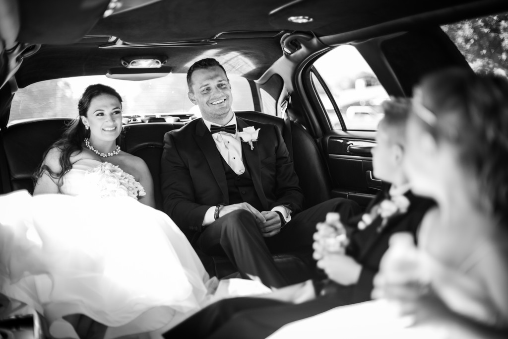 Bride and Groom in Limo Phoenix Wedding Photographer