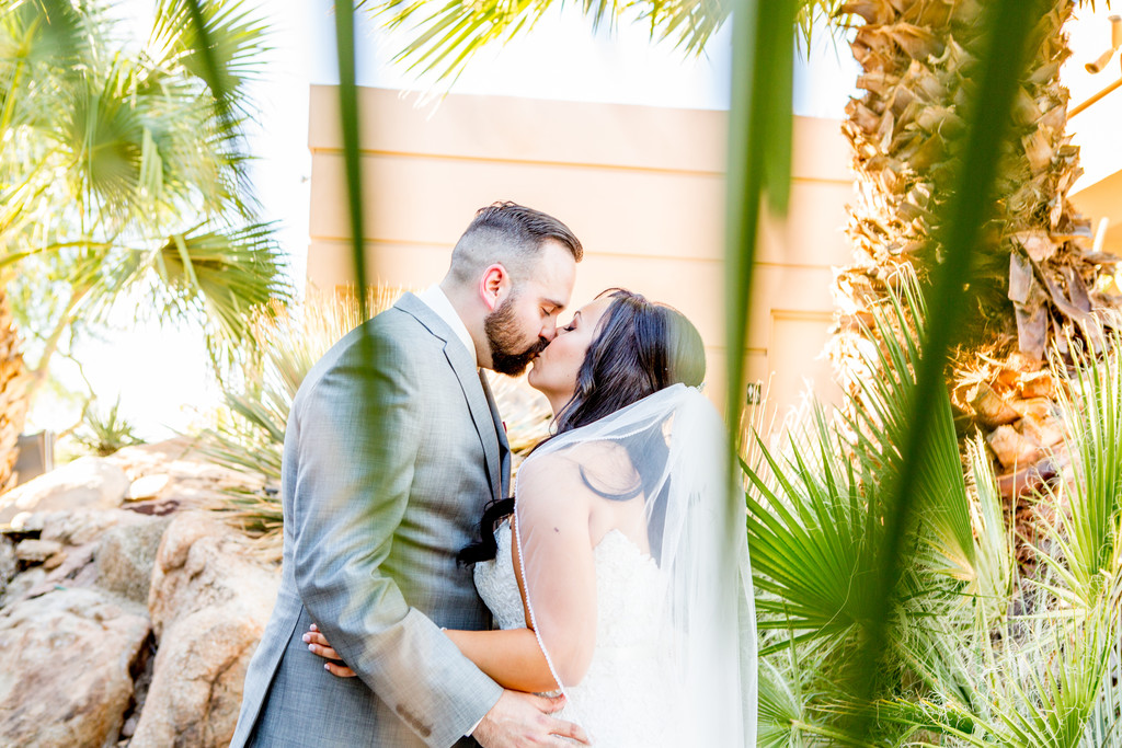 Kissing under palms Phoenix Wedding Photographer