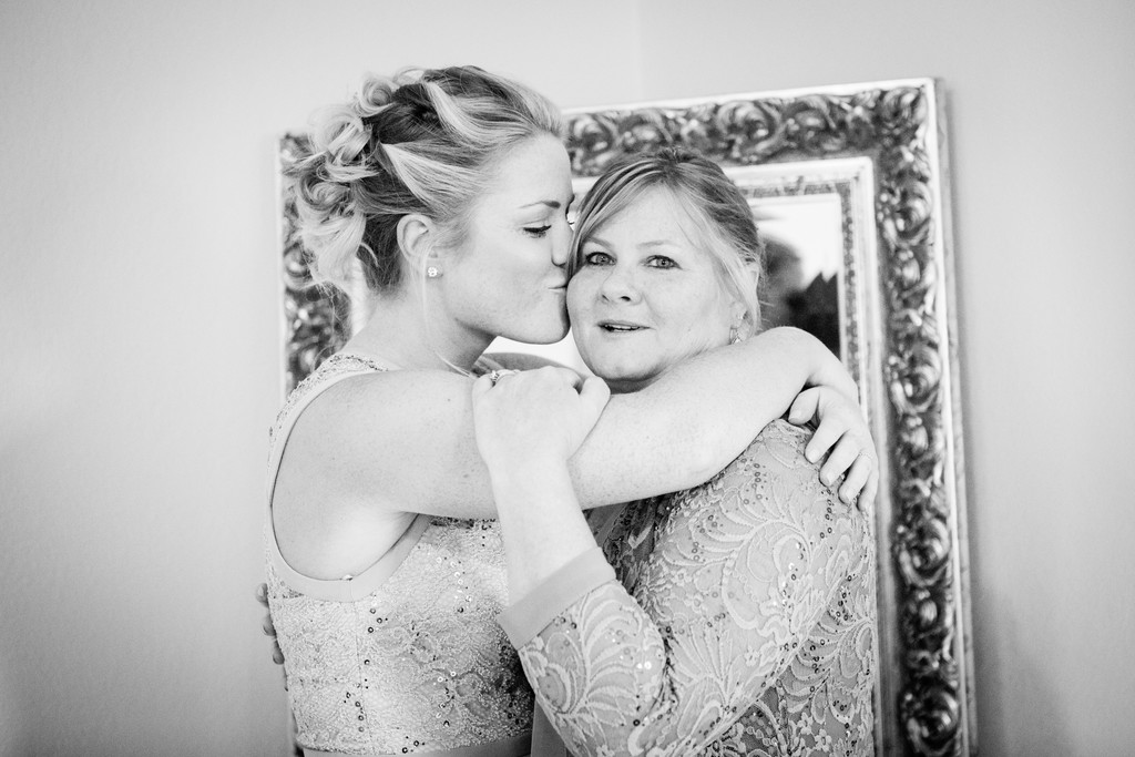 Bride kissing mother Phoenix Wedding Photographer