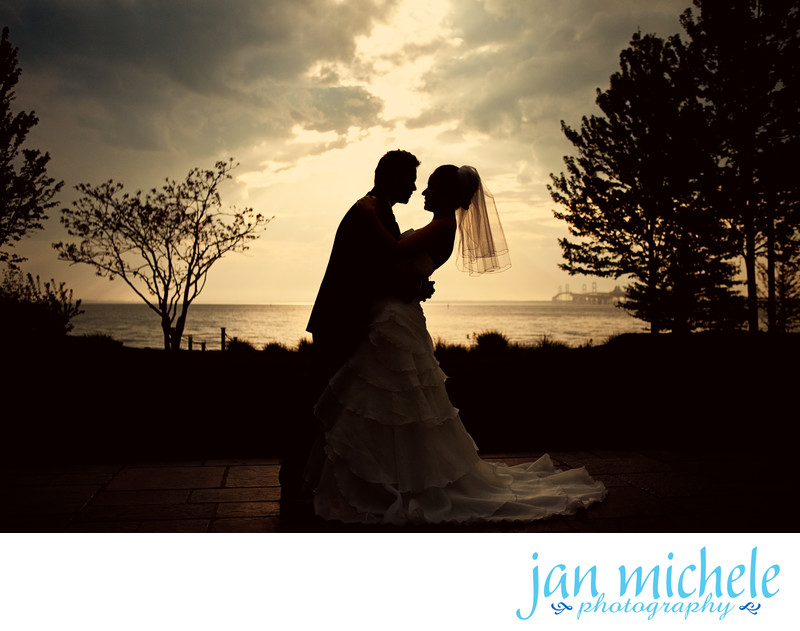Sunset silhouette of a bride and groom