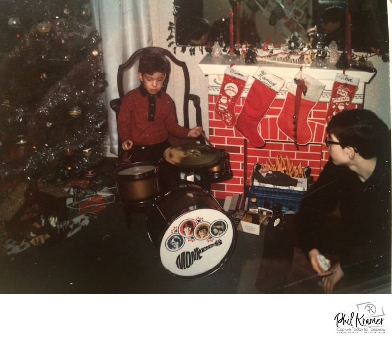 Photographer Phil Kramer drumming on The Monkees drumset