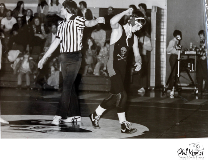 Photographer Phil Kramer winning a wrestling match for Cinnaminson