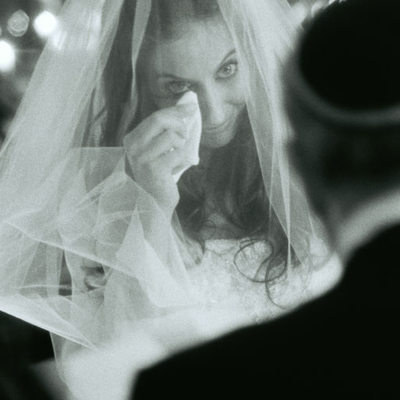 Bride Cries during Chuppah Ceremony With Husband On Jewish Wedding