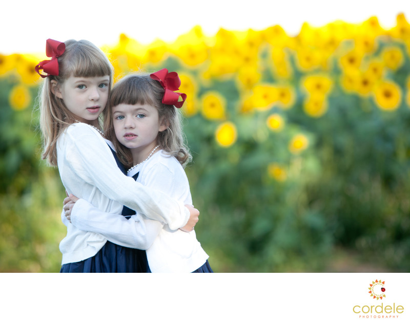 portrait of sisters in sunflower field at Colby Farm