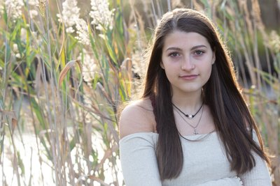 A senior portrait before and after taking in Gloucester Massachusetts with tall grass. Click here to see more before and after