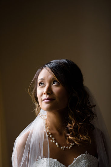Beautiful Filipino by window light bridal portrait