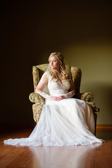 Bridal portrait by window light with bride in armchair