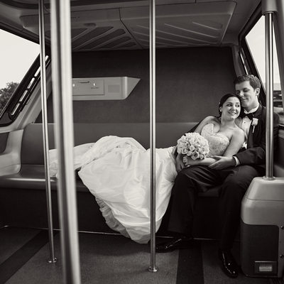 Bride and Groom Riding a Monorail