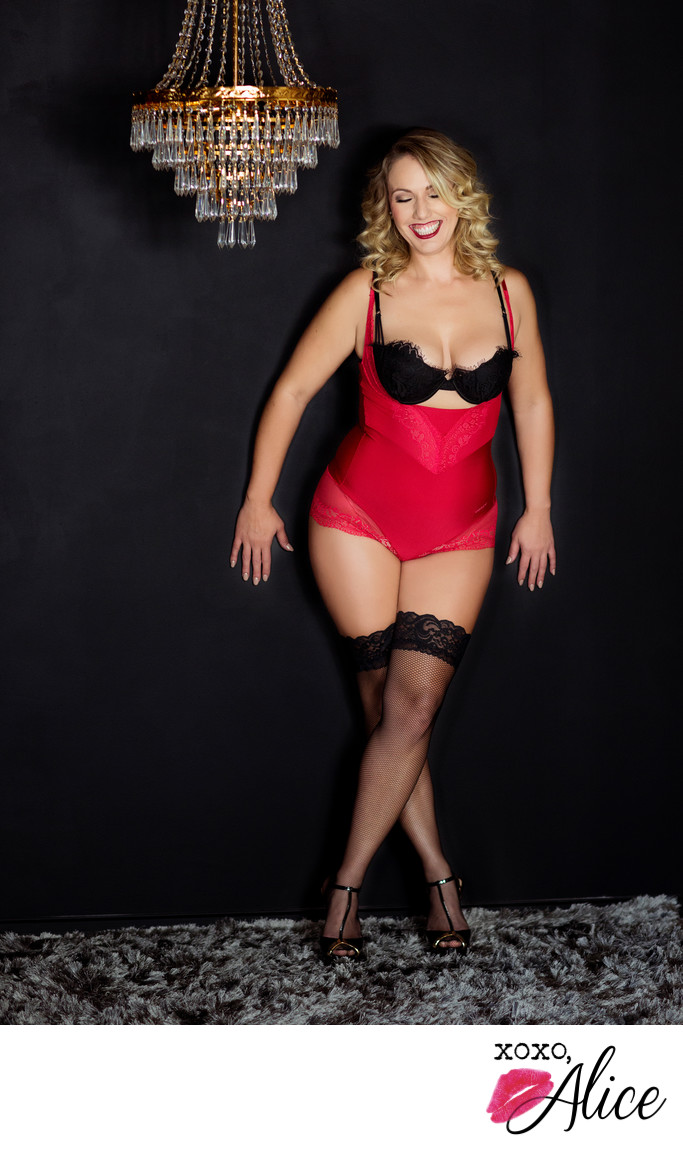 sexy flirty romantic boudoir images in STL red bodysuit
