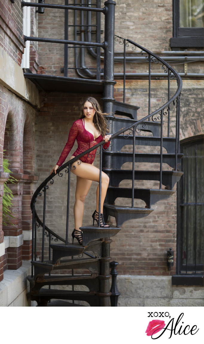 spiral staircase with model in red bodysuit brick