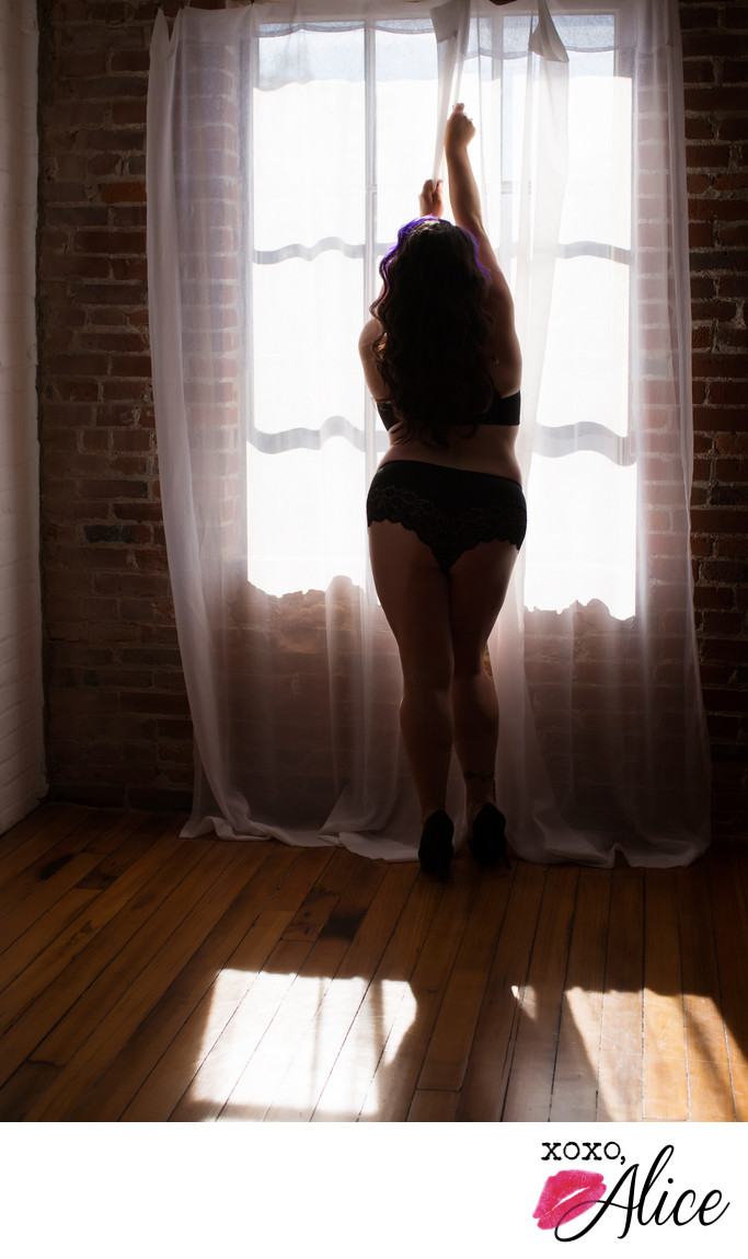 Sexy silhouette boudoir photography with a window