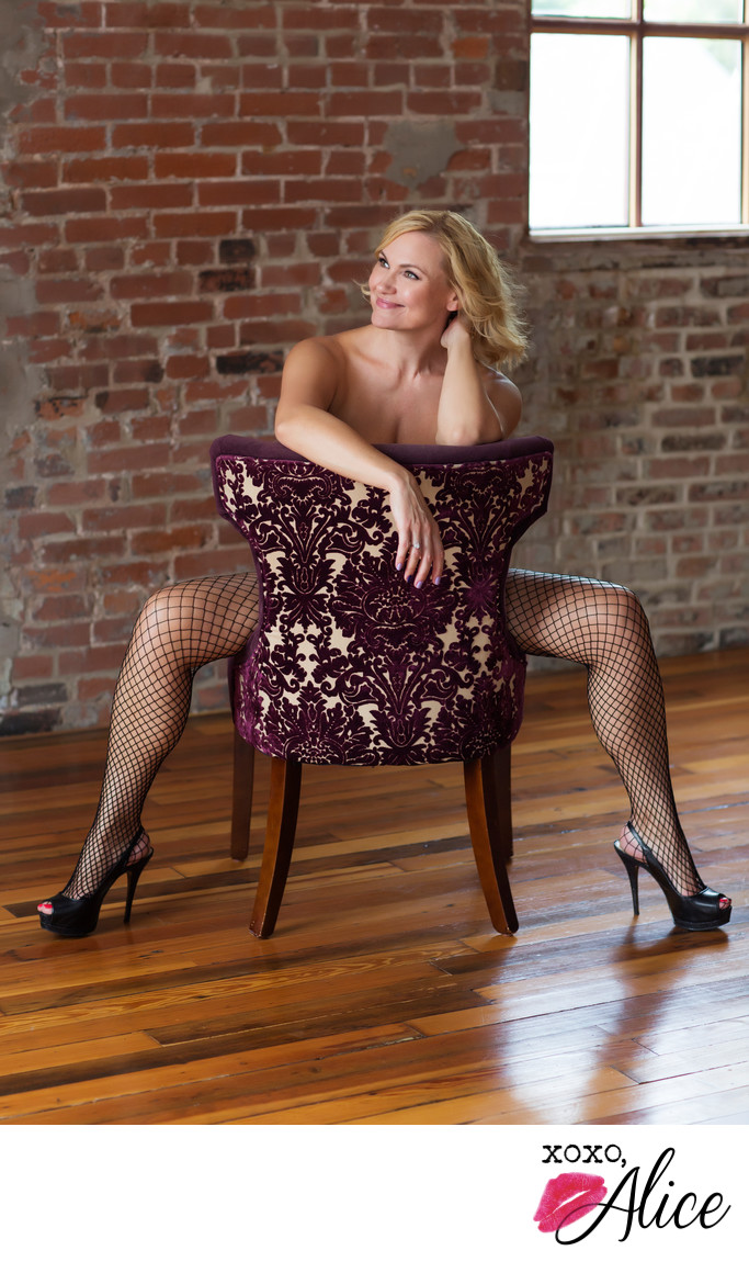 mature sexy woman boudoir portraits in fishnets