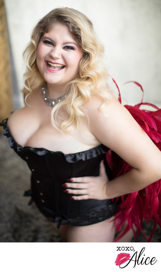 happy plus sized woman boudoir photography st louis