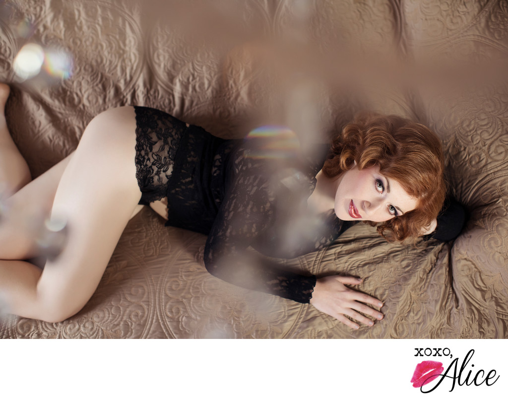 sexy glance studio photography boudoir redhead on bed