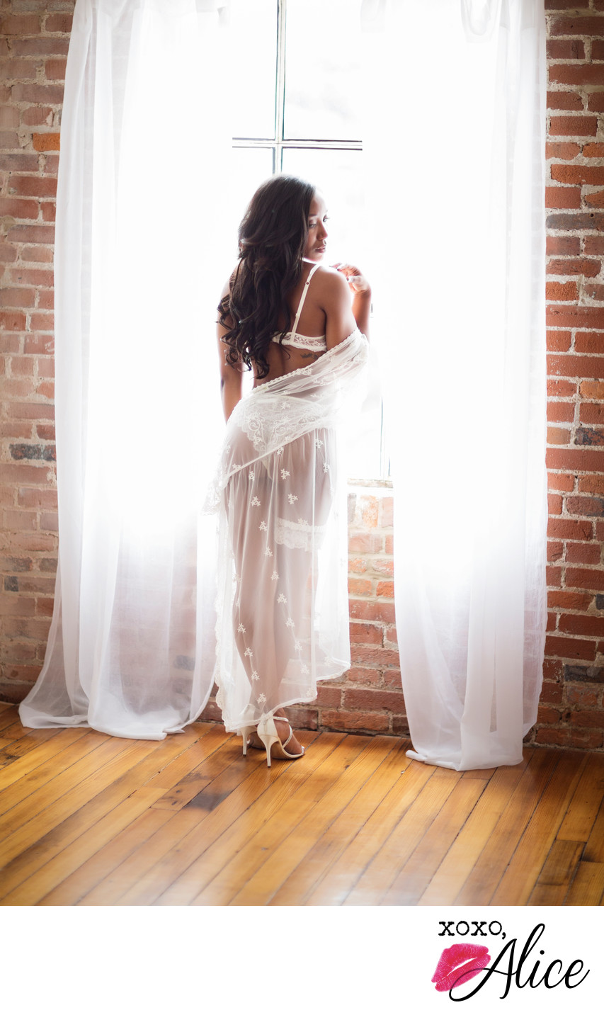 Boudoir photography black women romantic pose in window