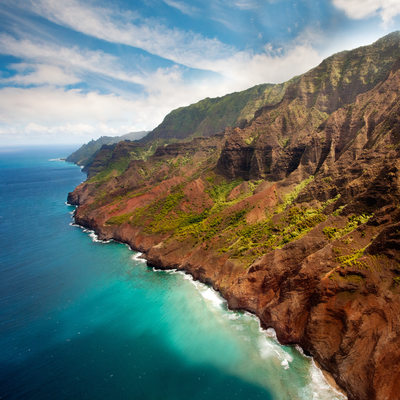 Kauai coastline with turquoise ocean as seen from sky