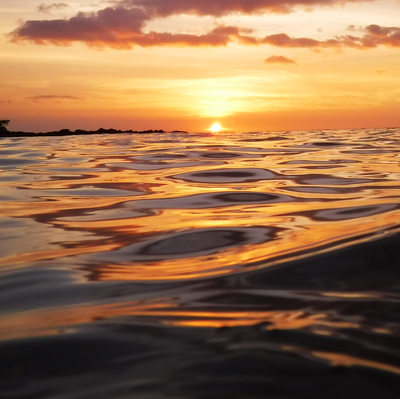 gorgeous ocean sunset with glossy reflective waves