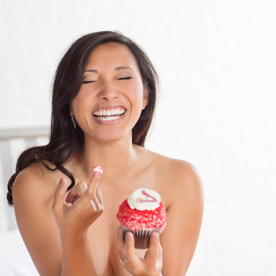 sexy happy laugh eating a cupcake saint louis boudoir