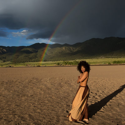 rainbow with natural hair desert dark skinned godess