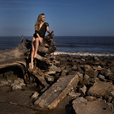 Epic beach photoshoot with driftwood and woven leather