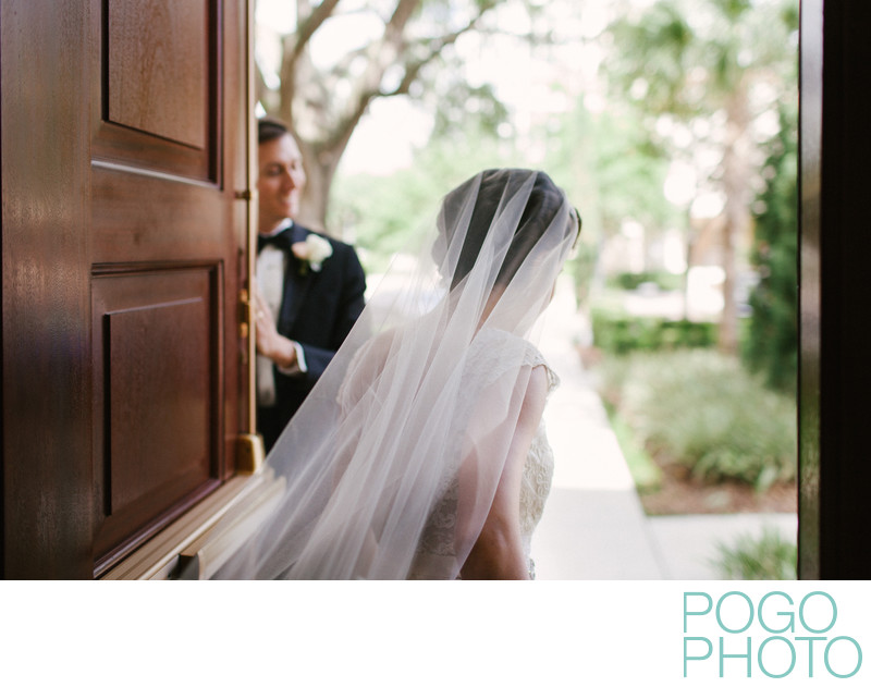 Bride exiting church into Orlando courtyard