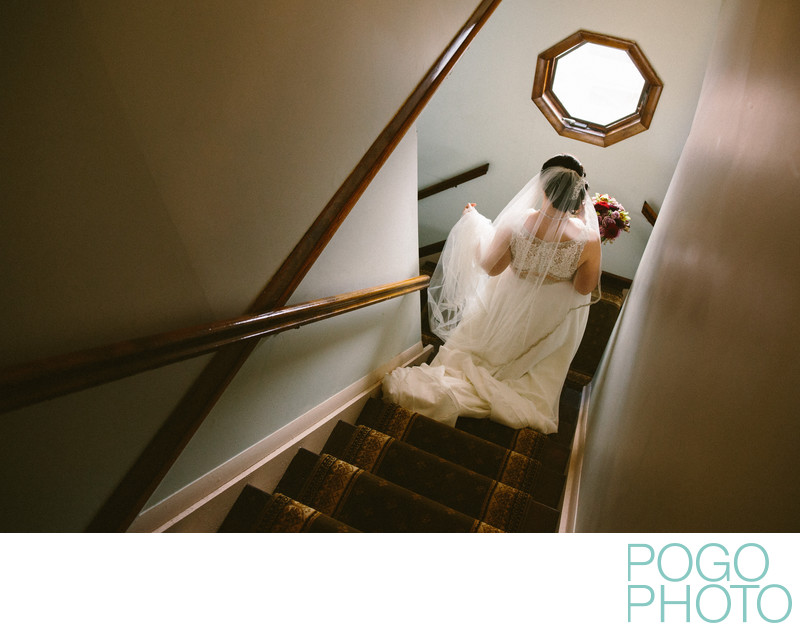 Photograph of Bride Descending a Staircase at Home