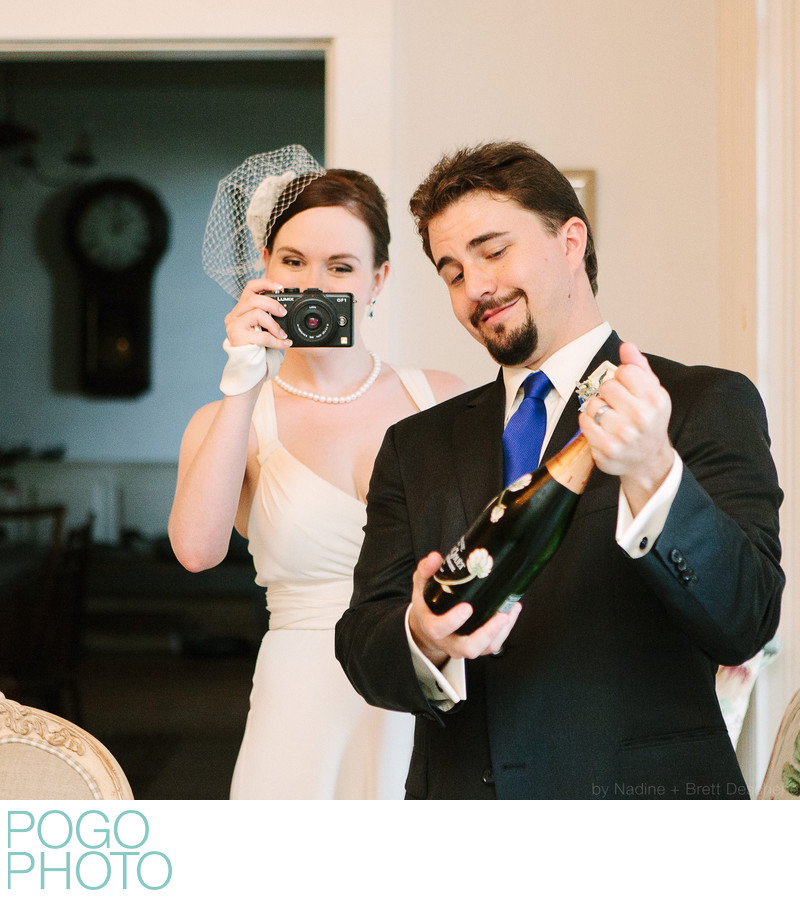 Pogo Wedding: Em with Lumix GF1, Steve with champagne