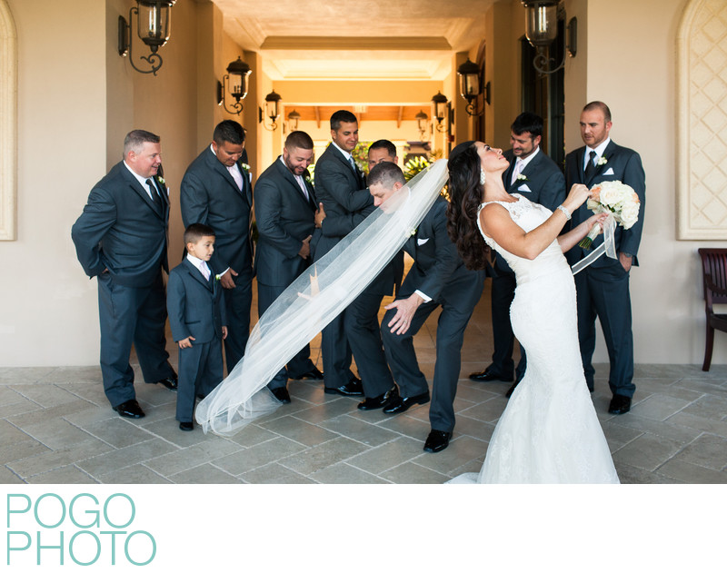 Groomsman Steps on Bride's Veil During Formal Photos