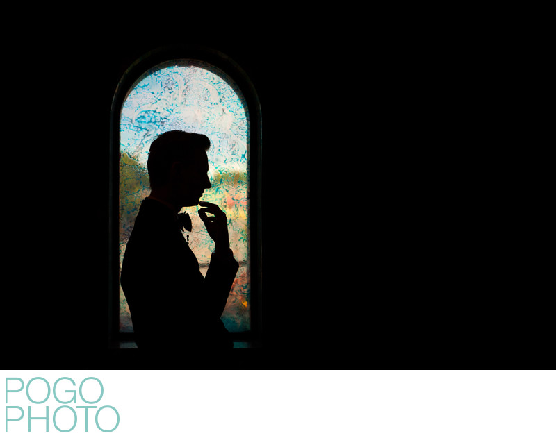 Groom Silhouette Portrait Against Colorful Window