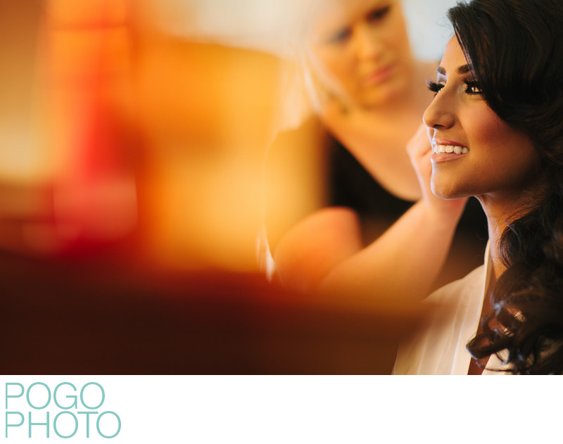 Makeup Artist Working on Bride in Colorful Prep Image