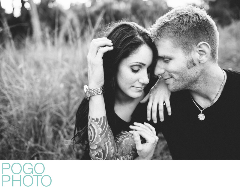 Tattooed Groom-to-be Snuggling with Fiancée in VT Field