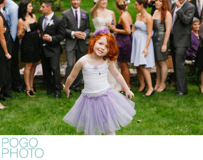 Vermont Flower Girl in Purple Tutu Goofs Off at Wedding