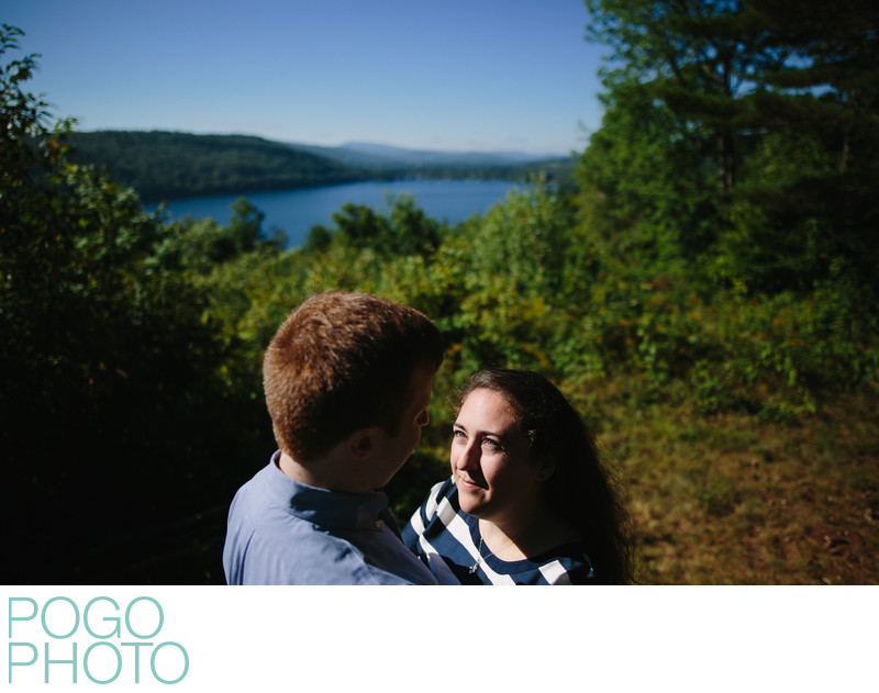 Vivid Engagement Photos Overlooking Secluded VT Lake