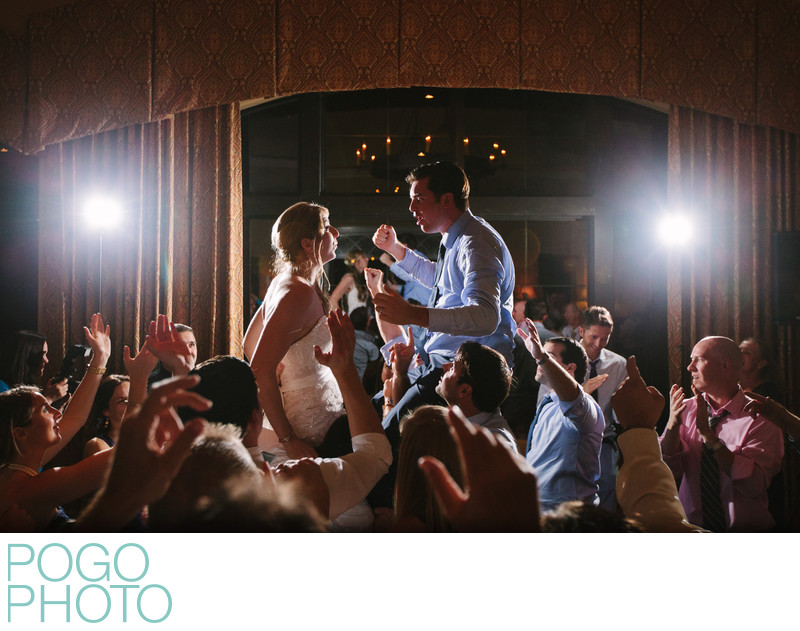 Wedding Couple on Guests Shoulders at Rocking Reception