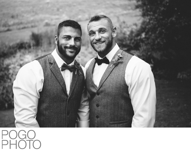 Timeless Image of Two Smiling Grooms at The Round Barn