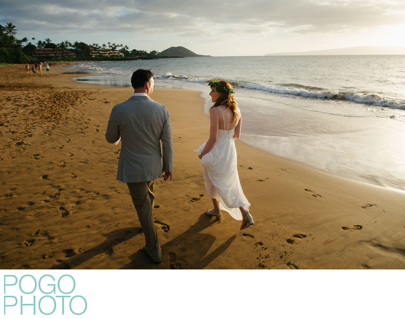 Post-ceremony stroll down the beach in Maui