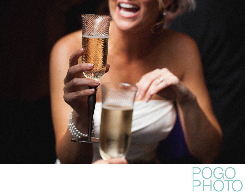 Happy bride toasts with her groom in Palm Beach Gardens