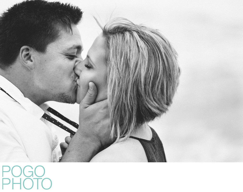 Black and White Photo of Passionate Kiss on the Beach