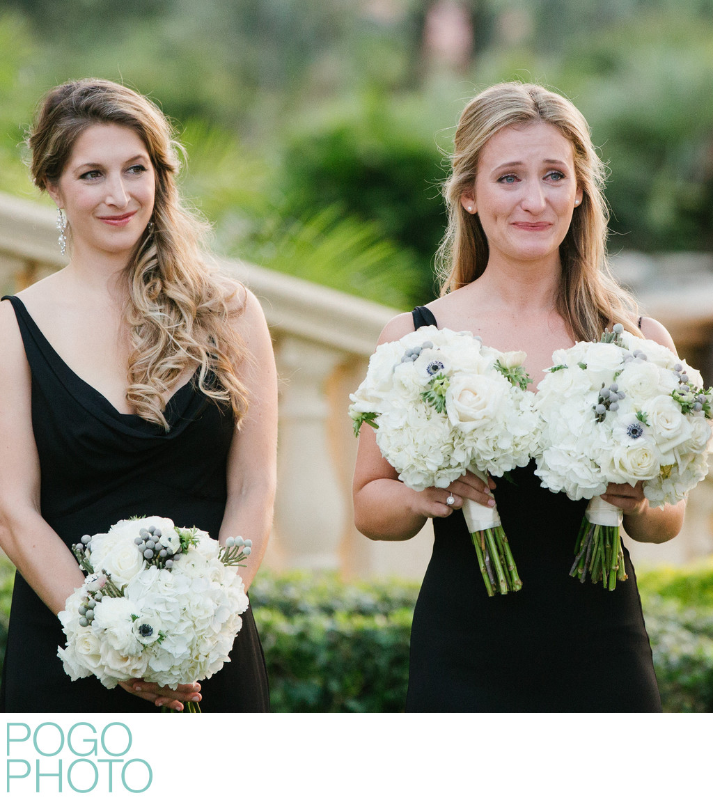 Maid of Honor Holds Bride's Bouquet with Happy Tears