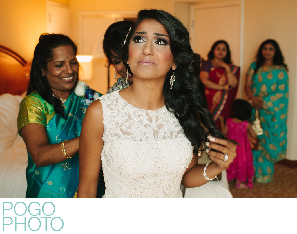 Indian Bride in White Lace Dress and Family in Saris