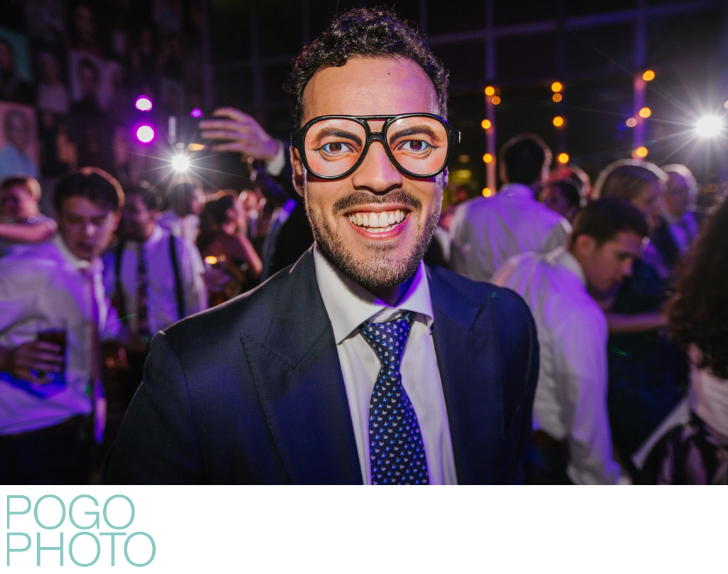 Funny Wedding Photo of Groomsman With Creepy Glasses
