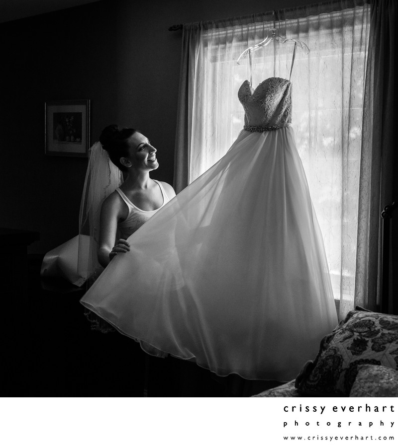 Bride with Wedding Dress by Window Light